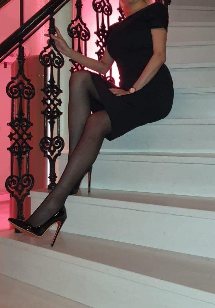 High-End Escort Girl Isabella in black dress